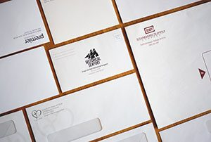 Letterheads and Envelopes sitting on a table