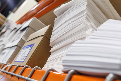 Stacks of envelopes on a shelf