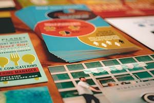 Stacks of postcards and rack cards