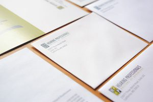 Various marketing materials including letterheads and envelopes