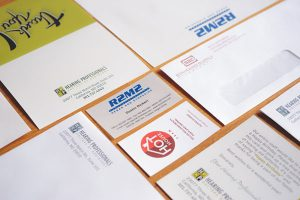 A variety of business cards, thank you cards, letterheads and envelopes
