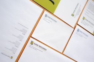 A variety of business cards, postcards, letterheads and envelopes