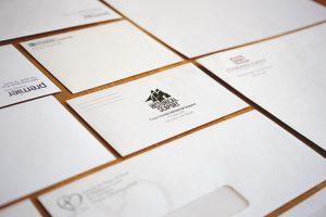 Printed envelopes organized across a table
